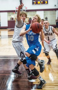 TOUGH DRIVE - Decatur's Austin Givens looks to get past Bridgeport's Reese Read Friday. Givens led the Eagles with 18 points. Messenger photo by Joe Duty