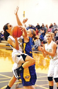 TOUGH LOSS - Alvord&#039;s Lauren Hart goes up for a lay-up against Brock Thursday. Brock handed the Lady Bulldogs their first district loss, 49-30. Messenger photo by Mack Thweatt