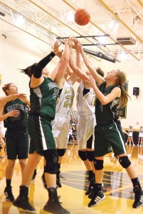 UP FOR GRABS - Alvord's Ariel Rogers and Marissa Schedcik fight for a loose ball against Paradise's Makenna Burt and Kaylee McConnell. Messenger photo by Mack Thweatt