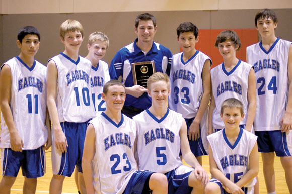 ALL SMILES - The Decatur seventh grade boys picked up a district championship Thursday. The team consists of (front row) Dane Fitzgerald, Charlie Doubrava and Drew Langto. Back row Mario Reyes, Joshua Sij, Dylan Nation, Sergio Sanchez, Jhett Parker and Mason Hix. Submitted photo