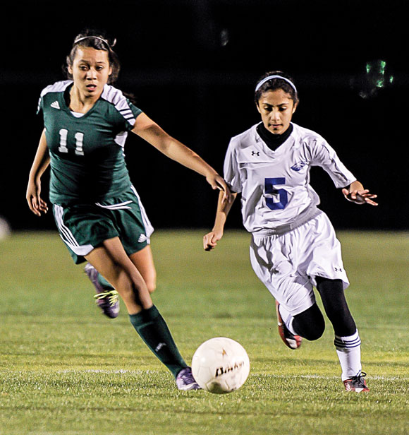 AROUND THE SIDE - Decatur's Paola Palomo tries to run down a Western Hills player. Messenger photo by Joe Duty