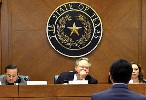 COMMITTEE RELATIONSHIPS - State Senator Craig Estes (center), flanked by Sen. Carlos Uresti and Committee Director Ren Newey, listens as Todd Staples, Texas Land Commissioner, discusses border security and water issues before the Senate Committee on Agriculture, Rural Affairs and Homeland Security, which Estes chairs. Messenger photo by Joe Duty