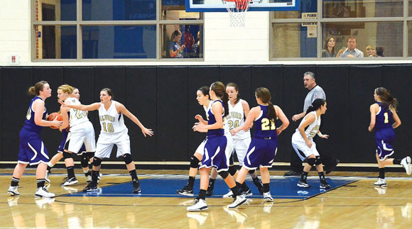 DEFENSE - Alvord's defense was suffocating in the second half against Godley only allowing the Lady Cats eight points in the final two quarters. Messenger photo by Mack Thweatt
