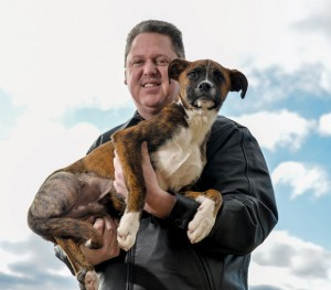 DOG DAYS ARE OVER - An unknown suspect or suspects left a six-month-old boxer for dead in a ditch along a highway in Newark. James Tucciarone found the dog with his back legs bound by a pair of pantyhose. Messenger photo by Joe Duty