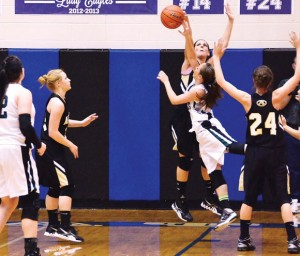 DOMINATING EFFORT - Alvord's Sam Hahn gets the block Friday against Paradise in the District 9-2A playoff for second place. The Lady Bulldogs won 66-47. Messenger photo by Mack Thweatt