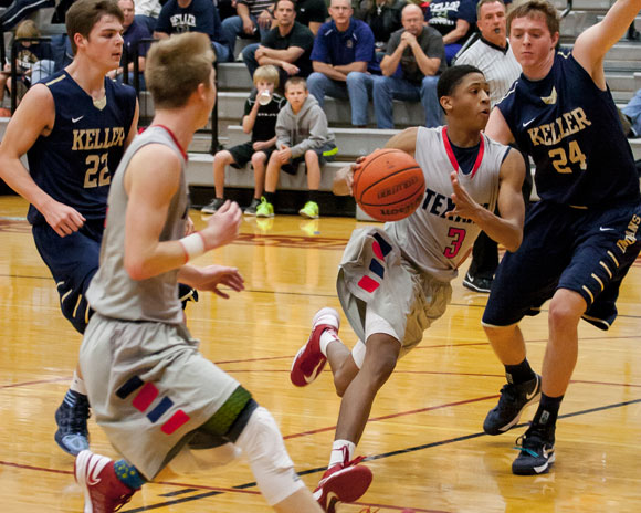 DRIVE TO THE HOOP - Peri James finds an open lane to the basket for the Texans. Messenger photo by Jimmy Alford