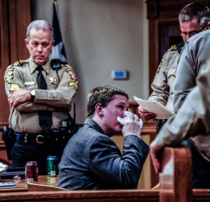 EMOTIONAL PROCEEDINGS - Danny Nalley uses a tissue given to him by a deputy immediately after his punishment was announced Thursday. District Court Bailiff Dick Wood watches Nalley's emotional reaction. Messenger photo by Joe Duty