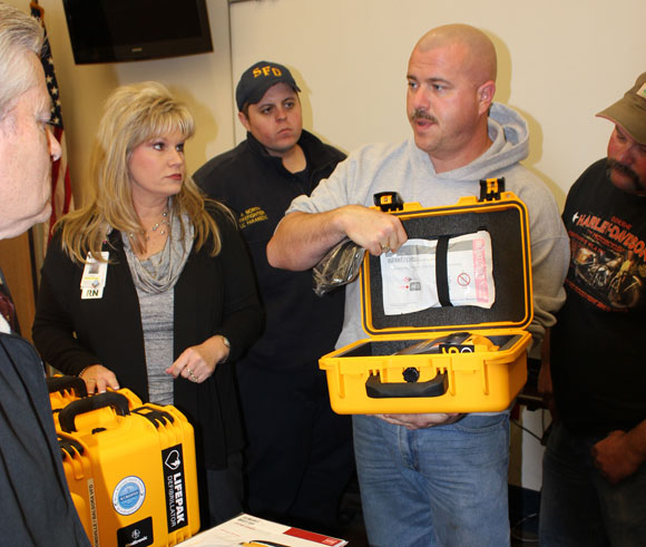 "EQUIPPED - Wise Regional Health System's director of radiology, John Neal, who is also the Paradise fire chief, was instrumental in obtaining the donation of an AED to every local department. Departments also receive an AED from the county. ""Those AEDs are kept on the trucks that respond to medical emergencies, not on the trucks that are used for fires, accidents, rescue, etc.,"" he said. ""Carrying that logic forward, heart attack is the No. 1 killer of firefighters, and very few of (those) heart attacks occur on medical calls. Therefore, when firefighters die, we are not equipped to save our own."" Submitted photo"