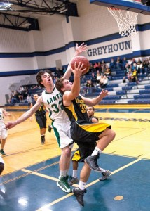 FROM BEHIND - Dylan Hightower goes up for two points with a Santo defender attempting to block. Hightower led both teams' scorers and was a big part in Chico's short-lived comeback Thursday. Messenger photo by Jimmy Alford