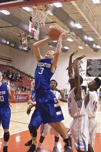 GETTING POSITION - Decatur's Cameron Mize gets inside for a layup against Dallas Roosevelt in their area round playoff game Friday. Messenger photo by Jimmy Alford