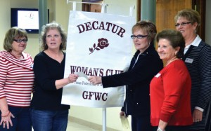 GIVING TO WARM - Decatur Woman's Club Treasurer Joyce Ogle presents WARM Director Ren  Ashmore with a check. Also pictured are (left) Sherry Henderson, DWC president-elect; (right, from left) Lou Hitt, DWC president; and LaDonna Wren, Tour of Homes benefactor chair. Submitted photo