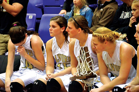 HEARTBREAK - Carley King, Katie Claborn, Sam Hahn and Ariel Rogers look on as Brock accepts the Class 2A Region II championship Saturday. Messenger photo by Mack Thweatt