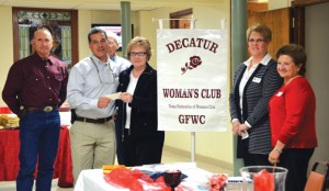 MAKING A DONATION - Decatur Woman's Club Treasurer Joyce Ogle presents Fabio Labrada, founder of Raquel's Wings for Life, with a $4,000 check. Also at the presentation were Jim West (far left) and (right, from left) LaDonna Wren, Tour of Homes benefactor chair; and Lou Hitt, DWC president. Submitted photo