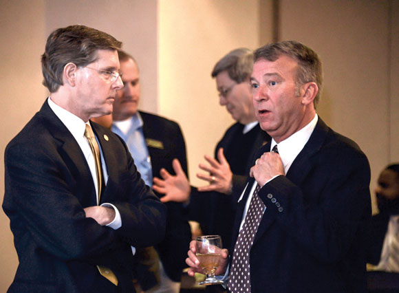 MEET AND GREET - Rep. Phil King and Decatur City Manager Brett Shannon find time to catch up and discuss local issues at a reception Monday night during Wise County Legislative Days in Austin. Messenger photo by Joe Duty