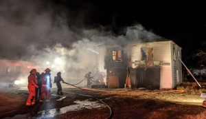 MUTUAL AID - Firefighters from Alvord, Decatur, Chico and Sunset responded to Tuesday's house fire, reported just after 8 p.m. Messenger photo by Joe Duty