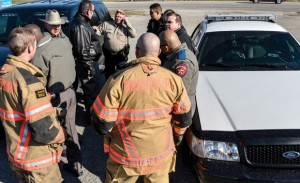 READY FOR ACTION - Emergency responders gather at a the command site near the Devon Energy natural gas processing plant in Bridgeport moments after a bomb threat was reported. Messenger photo by Joe Duty