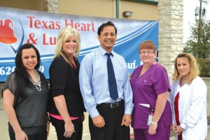 RIBBON CUTTING - The Decatur Chamber of Commerce held a ribbon cutting for Texas Heart and Lung Feb. 6. Pictured are Denise Snyder, receptionist; Lisa Read, clinic operations manager; Dr. Arshad Yousuf; Karen Lake, LVN; and Sabrina Himes, MA.