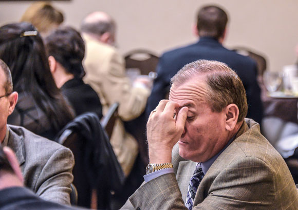 SCHOOL HEADACHES NOT OVER - Although Texas' public school finance system has been ruled unconstitutional, the system is unlikely to get fixed during this session - reason for the furrowed brow of Decatur ISD Superintendent Rod Townsend at Tuesday morning's Wise County Legislative breakfast in Austin. Messenger photo by Joe Duty