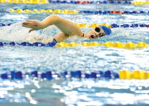 STATE BOUND - Decatur&#039;s Katey Rowden swims to a first place finish in the 50 freestyle at the regional meet in Mansfield Saturday. With the victory, Rowden will advance to the state meet next week. Messenger photo by Joe Duty