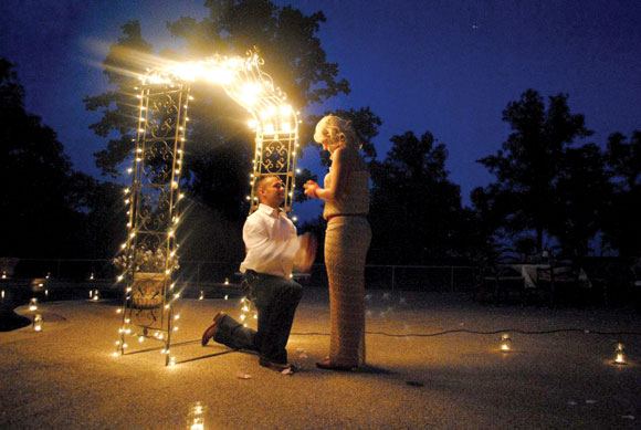 "THE PROPOSAL - Jerrod proposed to Ashlee in her backyard on July 14, 2012. ""It was ultimately breathtaking,"" Ashlee said. ""There were lights and candles surrounding my whole backyard. Jerrod was waiting for me under an archway of lights."" Submitted photo"