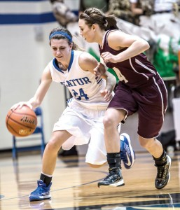 TIGHT DEFENSE - Decatur's Haley Dennard tries to get around the defense of Bridgeport's Bailey Thompson. Messenger photo by Joe Duty