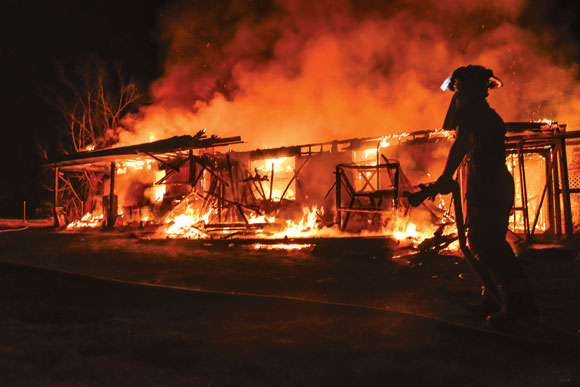 TOTAL LOSS - Despite the best efforts of firefighters from four departments, a blaze consumed a Boyd home early Sunday morning. Messenger photo by Joe Duty