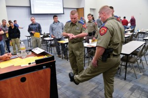 TOEING THE LINE - Law enforcement officers explain some of the field sobriety test techniques of the Advanced Roadside Impaired Driving Course (ARIDE). Messenger photo by Joe Duty