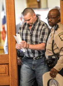 TRYING DAY - Richard Lee Sherman is led out of the courtroom by Deputy Paul Booker Wednesday moments after a jury found Sherman guilty of indecency with a child. Messenger photo by Joe Duty