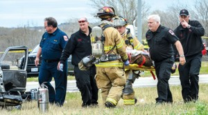 CRITICAL CONDITION - Wise County medics and Decatur firefighters carry suspect Evan S. Ebel, 28, of Colorado, to a waiting ambulance. Ebel was flown from Wise Regional Health System in Decatur to John Peter Smith Hospital in Fort Worth where he was declared brain dead and later deceased following his shoot-out with Wise County law enforcement. Messenger photo by Joe Duty