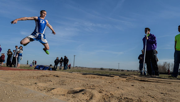 FLYING HIGH - Decatur's Tyler Wier takes flight on his long jump attempt. Messenger photo by Joe Duty