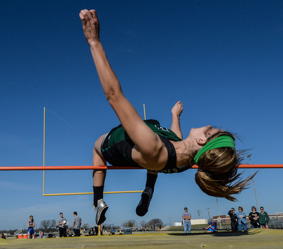FLYING TO THE TOP - Paradise's Amber French leaps her way to a first place finish in the high jump at the Wise County Meet in Alvord Saturday. Messenger photo by Joe Duty