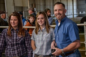 GOING NON-STOP - Decatur High School agriculture education teacher and FFA adviser Jim Allsup (right) and students Shelbie Chandler and Brittney Hubbard prepare for the broiler show Monday at the Wise County Youth Fair. Messenger photo by Joe Duty