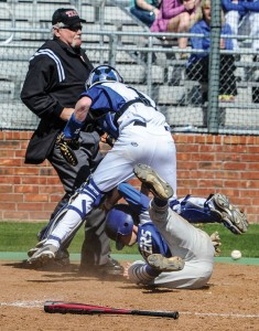 HARD EARNED RUN - Decatur catcher Cain Lowe scrambles for the baseball as the Gunter base runner tumbles in safely. Messenger photo by Joe Duty
