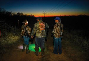 HUNTER'S RIDGE - Tyler Chapman, Kory Chapman and Andrew Gage have a long line of visibility for hunting wild hogs that cross the land. Messenger photo by Joe Duty