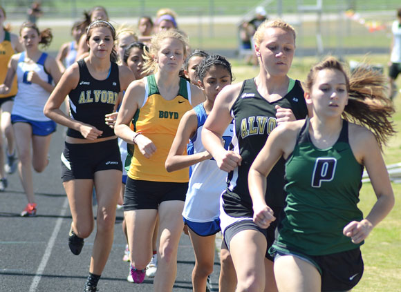 IN THE PACK - Area runners make their way around the track at Alvord Saturday. Messenger photo by Mack Thweatt