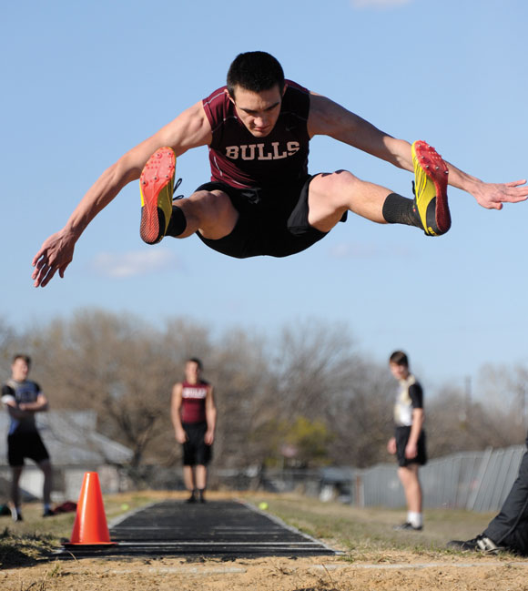 IN THE SAND - Bridgeport's Hunter Gantt takes a running leap during the long jump Thursday at Paradise's meet. Messenger photo by Joe Duty