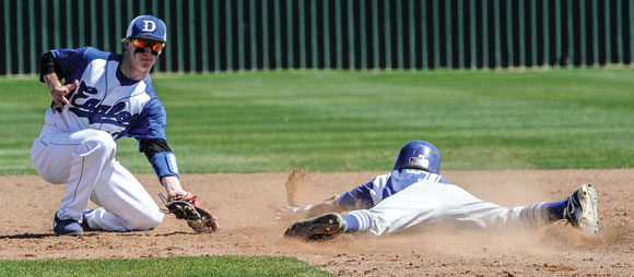 LITTLE LATE - Clayton Egle fields the throw Wednesday as the Gunter base runner slides in safely. The Tigers went on to a 5-0 victory. Messenger photo by Joe Duty