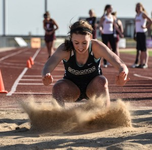 NICE LANDING - Bridgeport's Bailey Thompson splashes the sand in the long jump pit at the Sanger Meet Thursday. Messenger photo by Joe Duty