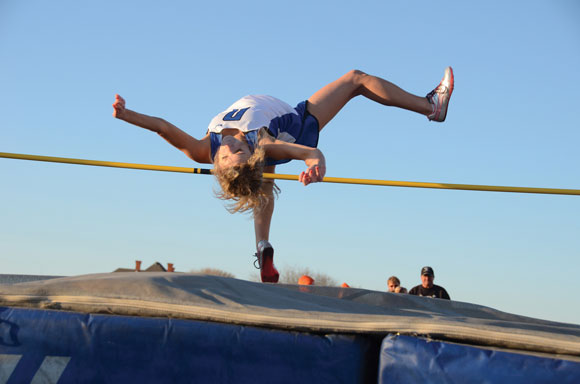 RAISING THE BAR - Decatur's Bailey Berry flings herself up at the high jump.  Messenger photo by Mack Thweatt