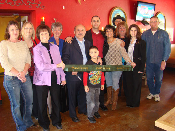 RIBBON CUTTING - The Paradise Chamber of Commerce held a ribbon cutting for Jorge's Mexican Restaurant March 1. Pictured with the owners Jorge Pinto Sr. and Paul Naquin and family members Lorena Chadwell and Paul Naquin Jr. (center) are Chamber members (left to right) Laura Foster, Teresa Moody, Shelly Prost, Judy Flanagin, Robert and Deborah Mann, Cher Tilghman and Mayor Sam Starr. Submitted photo