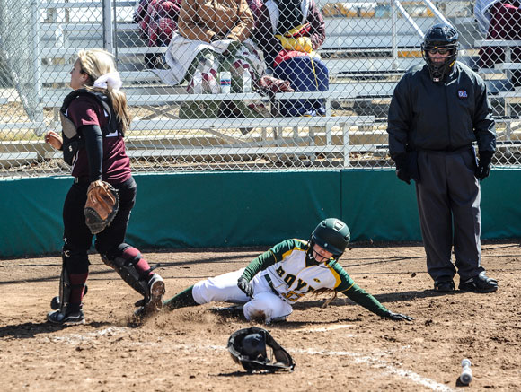 SAFE! - Boyd's Amber Bowen slides in with another run for the Lady Jackets Monday. Messenger photo by Joe Duty