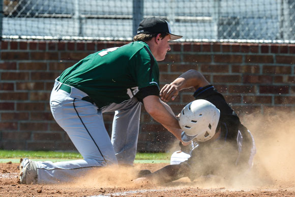 SAFE! - Decatur's Christain Carrillo slides into home ahead of the tag. Messenger photo by Joe Duty