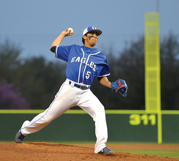 SETBACK - Decatur's Johnny Murillo delivers a pitch during the first inning Friday against Krum. The Eagles lost their first district game, 11-4. Messenger photo by Joe Duty