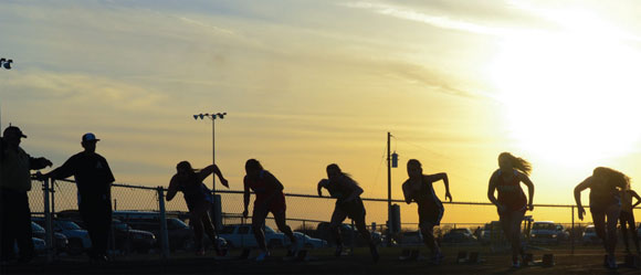 SETTING SUN - Runners take off from the starting line late in the day at the Alvord Track Meet Thursday. Messenger photo by Mack Thweatt