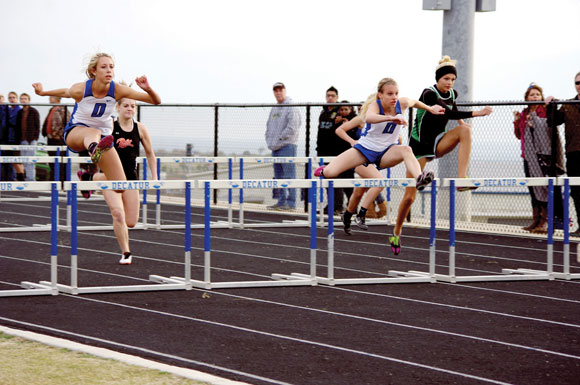 TOP FINISHERS - Decatur's Macen Stripling (right) finished second and Nicole Neighbors took first in the 100 hurdles Thursday. Photo submitted by Ashley Kyle