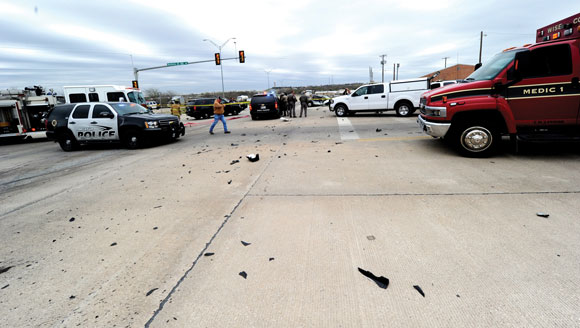 TOTAL CARNAGE - After Evan S. Ebel rammed a car into the side of a rock hauler, shattered glass and parts of the 1991 Cadillac spilled across the intersection of U.S. 380 and U.S. West Business 380. Messenger photo by Joe Duty