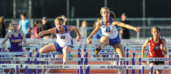 BY THAT MUCH - Macen Stripling narrowly edged Natalie Neighbors in the 100 hurdles at the District 9-3A meet in Sanger Thursday. The Lady Eagles held on for a district title. Messenger photo by Joe Duty