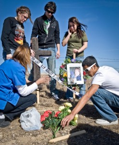 CLASSES CROSS - After Chelsea Lunt's death, her classmates created a shrine where the wreck that killed her occured. The memorial included a cross and other items to honor her memory. Messenger photo by Joe Duty