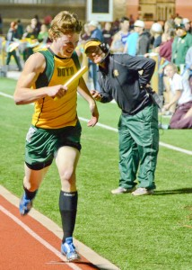 FIRST PLACE - Boyd's Dylan Noel finishes off a Yellowjacket victory in the mile relay. Messenger photo by Mack Thweatt