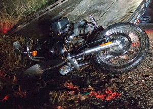 FLIPPED AND CRASHED - Vernon Allen Wingate's 2008 Harley Davidson motorcycle is being dragged onto a tow truck's bed. Messenger photo by Jimmy Alford